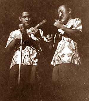 Eddie Kamae and Shoi Ikemi perform with Ray Kinney's troupe circa 1948