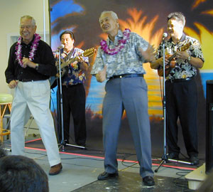 Fred and Sam Kamaka entertain the crowd with a hula at the induction of their father Samuel Kamaka at Ukulele Expo 2000