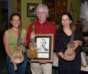 Donelle Camarillo (portrait artist), and Nuni Walsh (UHoFM) presenting Dick Boak of the Martin Guitar Company with FH Martin's inductee portrait, April, 2007
